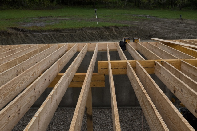 A house in a field for Floor joist bridging